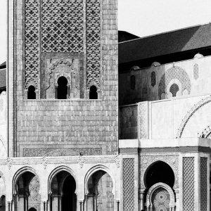 Figure walking square in front of Grande Mosquée Hassan II
