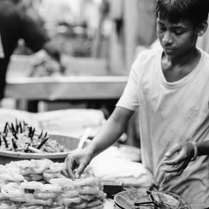 Young man selling sweets called Jalebi