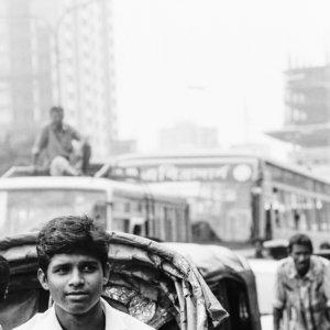 Smiling passenger on cycle rickshaw