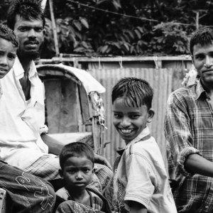 Men and boys around cycle rickshaw