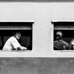 Man wearing empty look on train