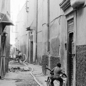 Boy waking bicycle