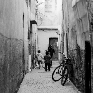Kids playing in lane in old quarter