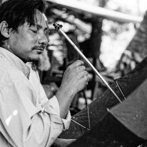 Man repairing umbrella
