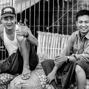 Men sitting on potatoes