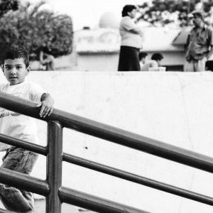 Boy staring on stairway