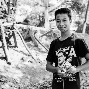 Boy winding a thread