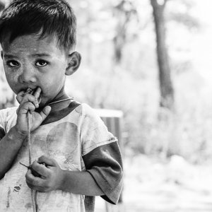 Little boy holding spinning top