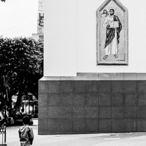 Boy standing in front of saint