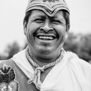 Man laughing in costume