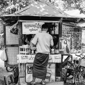 Man buying at kiosk