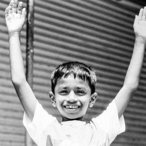 Boy raising arms up