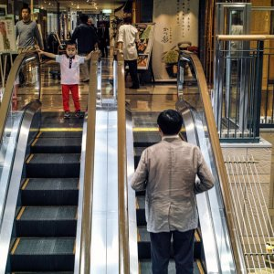 Boy watching escalator
