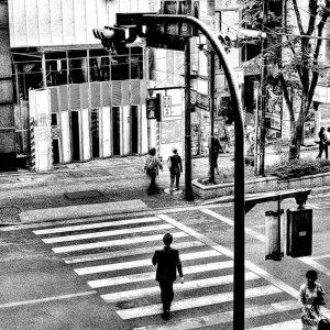Businessman walking on striped pattern