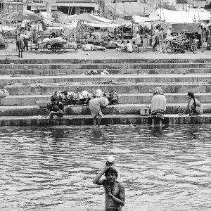 Man soaking in river