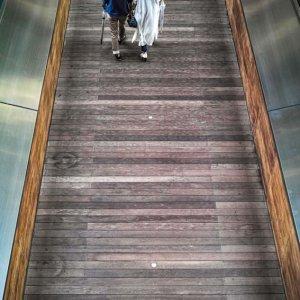 Couple walking connecting corridor