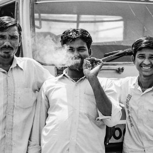 Three men and cigarette smoke