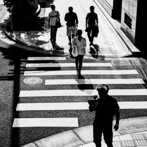 Silhouettes on sidewalk