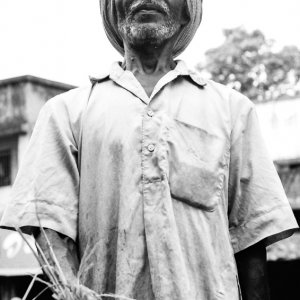 man carrying straw