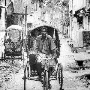Cycle rickshaw running dirt road