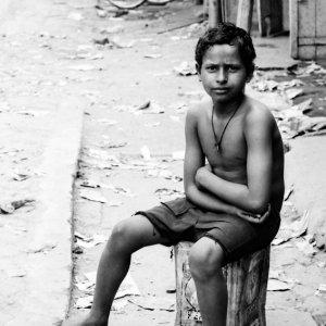 Boy in messy street