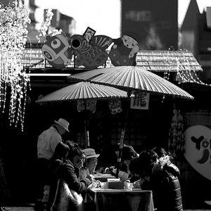 People eating under umbrella