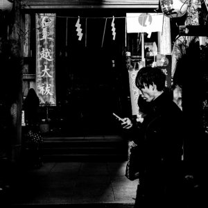 Young man walking in front of a shrine