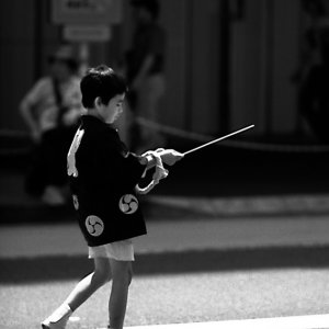 Boy having pole