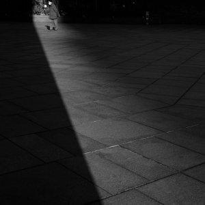 old man near long shadow