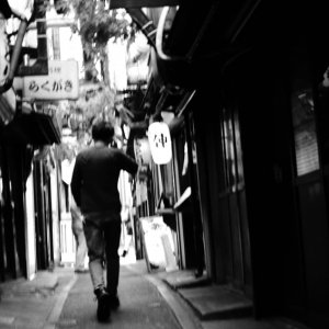 Man in lane called Omoide Yokocho
