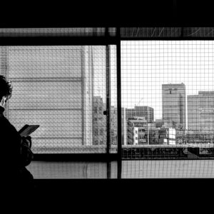 Silhouetted man by window