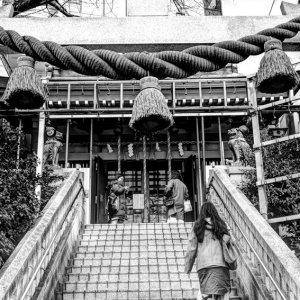 Woman entering Shinto shrine