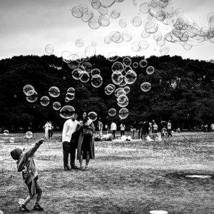 boy standing against soap bubbles