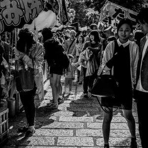 people in the festival in Nezu Jinja