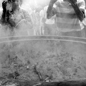 Two persons standing at incense burner