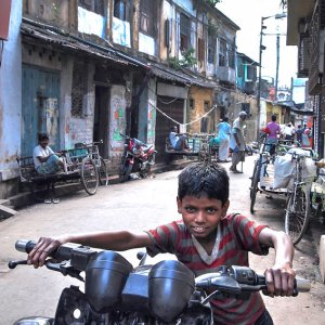 Boy walking motorcycle