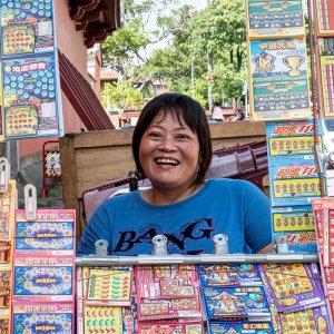 woman selling lottery