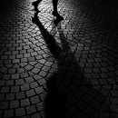 Shadow On A Cobbled Street