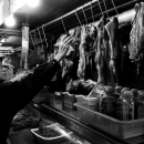Elderly Man Extending His Arm At A Butcher @ Taiwan