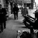 Street Vendor By A Pillar