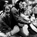 Mother And Her Daughters On The Same Motorbike
