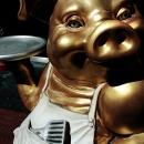 得意げな顔をした黄金の豚