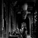 Woman Praying In Baoan