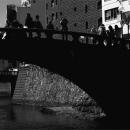 Silhouettes On The Black Bridge