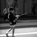 Boy Walking With A Pole