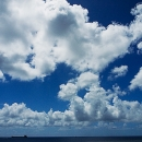 Clouds And Small Silhouette Of A Tanker