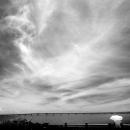 空の下の傘と池間大橋のシルエット