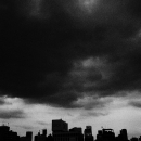 Silhouettes Of Buildings And Dark Clouds