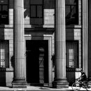 Bicycle Running In Front Of Corinthian Columns