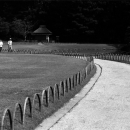 Three Persons Walking The Winding Path In Korakuen